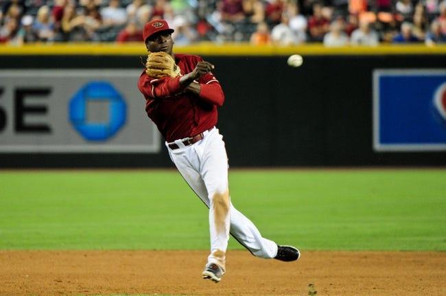 Jul 9, 2014; Phoenix, AZ, USA; Arizona Diamondbacks shortstop Didi Gregorius (1) throws to first base during the eighth inning against the Miami Marlins at Chase Field. Mandatory Credit: Matt Kartozian-USA TODAY Sports