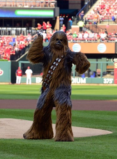 Jul 9, 2014; St. Louis, MO, USA; Chewbacca throws out the first pitch before a game between the St. Louis Cardinals and the Pittsburgh Pirates on Star Wars night at Busch Stadium. Mandatory Credit: Jeff Curry-USA TODAY Sports