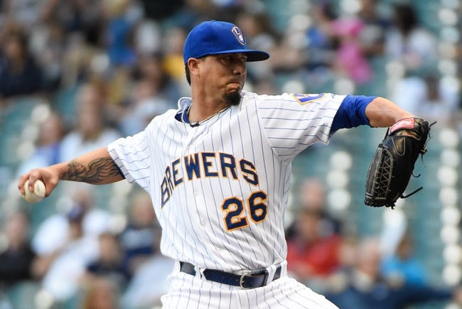 Jul 9, 2014; Milwaukee, WI, USA;  Milwaukee Brewers pitcher Kyle Lohse (26) pitches in the first inning against the Philadelphia Phillies at Miller Park. Mandatory Credit: Benny Sieu-USA TODAY Sports