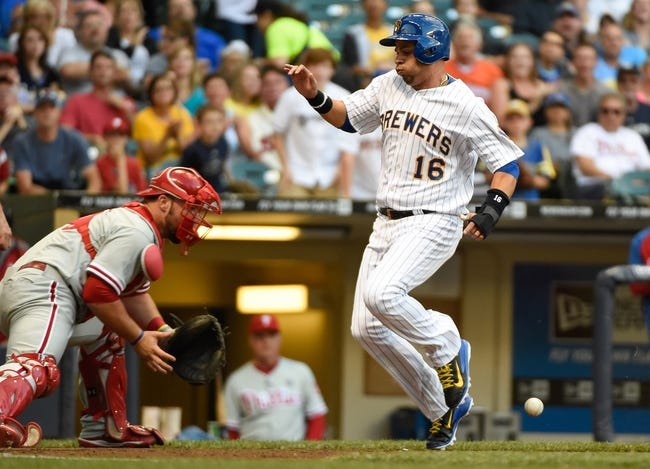 Jul 9, 2014; Milwaukee, WI, USA; Milwaukee Brewers third baseman Aramis Ramirez (16) scores a run as  Philadelphia Phillies catcher Cameron Rupp (29) fields the throw in the second inning at Miller Park. Mandatory Credit: Benny Sieu-USA TODAY Sports