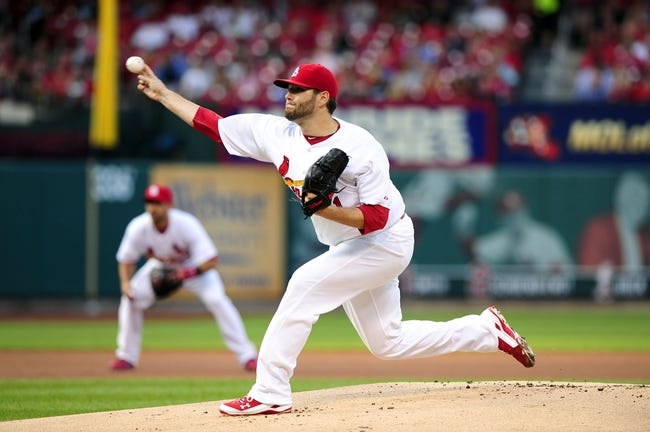 Jul 9, 2014; St. Louis, MO, USA; St. Louis Cardinals starting pitcher Lance Lynn (31) throws to a Pittsburgh Pirates batter during the first inning at Busch Stadium. Mandatory Credit: Jeff Curry-USA TODAY Sports