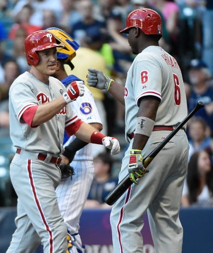 Jul 9, 2014; Milwaukee, WI, USA;  Philadelphia Phillies second baseman Chase Utley (26) is greeted by first baseman Ryan Howard (6) after hitting a solo home run in the first inning against the Milwaukee Brewers at Miller Park. Mandatory Credit: Benny Sieu-USA TODAY Sports
