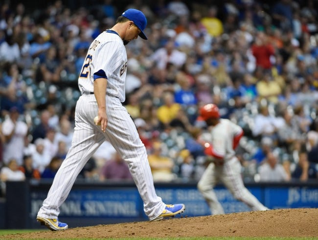 Jul 9, 2014; Milwaukee, WI, USA;  Milwaukee Brewers pitcher Kyle Lohse (26) walks back to the mound after giving up a 2-run home run to Philadelphia Phillies shortstop Jimmy Rollins (11) in the sixth inning at Miller Park. Mandatory Credit: Benny Sieu-USA TODAY Sports