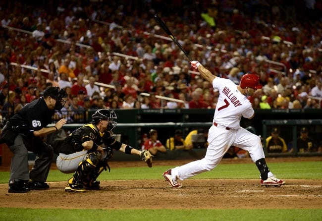 Jul 9, 2014; St. Louis, MO, USA; St. Louis Cardinals left fielder Matt Holliday (7) hits a one run single off of Pittsburgh Pirates starting pitcher Brandon Cumpton (not pictured) during the fourth inning at Busch Stadium. Mandatory Credit: Jeff Curry-USA TODAY Sports