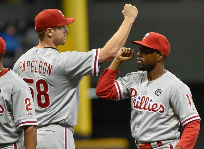 Jul 9, 2014; Milwaukee, WI, USA; Philadelphia Phillies shortstop Jimmy Rollins celebrates with pitcher Jonathan Papelbon (58) after beating the Milwaukee Brewers 4-1 at Miller Park. Mandatory Credit: Benny Sieu-USA TODAY Sports
