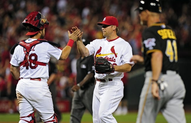 Jul 9, 2014; St. Louis, MO, USA; St. Louis Cardinals relief pitcher Trevor Rosenthal (26) celebrates with catcher Tony Cruz (48) after defeating the Pittsburgh Pirates at Busch Stadium. Cardinals defeated the Pirates 5-2. Mandatory Credit: Jeff Curry-USA TODAY Sports