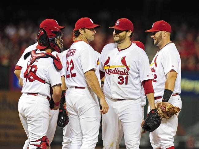 Jul 9, 2014; St. Louis, MO, USA; St. Louis Cardinals starting pitcher Lance Lynn (31) is removed from the game by manager Mike Matheny (22) during the seventh inning against the Pittsburgh Pirates at Busch Stadium. Cardinals defeated the Pirates 5-2. Mandatory Credit: Jeff Curry-USA TODAY Sports