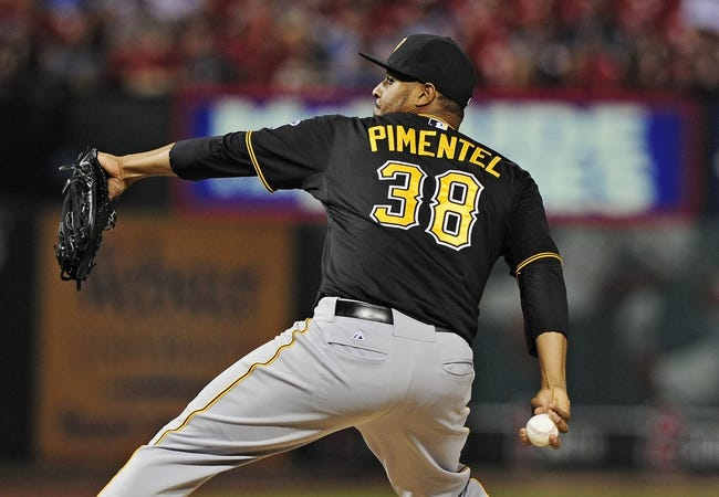 Jul 9, 2014; St. Louis, MO, USA; Pittsburgh Pirates relief pitcher Stolmy Pimentel (38) throws to a St. Louis Cardinals batter during the eighth inning at Busch Stadium. Cardinals defeated the Pirates 5-2. Mandatory Credit: Jeff Curry-USA TODAY Sports