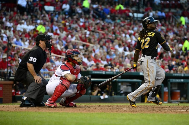 Jul 10, 2014; St. Louis, MO, USA; Pittsburgh Pirates center fielder Andrew McCutchen (22) hits a one run single off of St. Louis Cardinals starting pitcher Shelby Miller (not pictured) during the fifth inning at Busch Stadium. Mandatory Credit: Jeff Curry-USA TODAY Sports