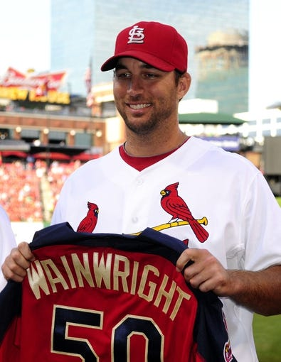 Jul 10, 2014; St. Louis, MO, USA; St. Louis Cardinals starting pitcher Adam Wainwright (50) poses with his All-Star jersey before a game against the Pittsburgh Pirates at Busch Stadium. Mandatory Credit: Jeff Curry-USA TODAY Sports