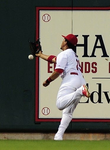 Jul 10, 2014; St. Louis, MO, USA; St. Louis Cardinals center fielder Jon Jay (19) is unable to catch a two run double hit by Pittsburgh Pirates left fielder Josh Harrison (not pictured) during the sixth inning at Busch Stadium. Pirates defeated the Cardinals 9-1. Mandatory Credit: Jeff Curry-USA TODAY Sports