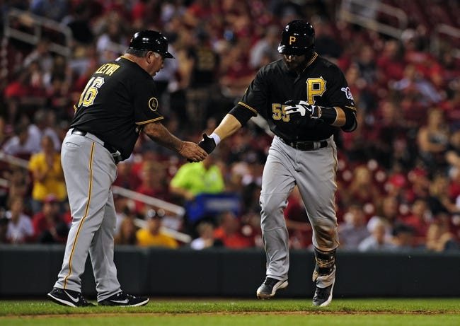Jul 10, 2014; St. Louis, MO, USA; Pittsburgh Pirates catcher Russell Martin (55) is congratulated by third base coach Nick Leyva (16) after hitting a solo home run off of St. Louis Cardinals relief pitcher Jason Motte (not pictured) during the ninth inning at Busch Stadium. Pirates defeated the Cardinals 9-1. Mandatory Credit: Jeff Curry-USA TODAY Sports