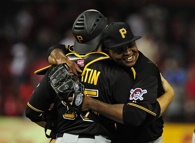 Jul 10, 2014; St. Louis, MO, USA; Pittsburgh Pirates starting pitcher Edinson Volquez (36) celebrates with catcher Russell Martin (55) after throwing a complete game against the St. Louis Cardinals at Busch Stadium. Pirates defeated the Cardinals 9-1. Mandatory Credit: Jeff Curry-USA TODAY Sports