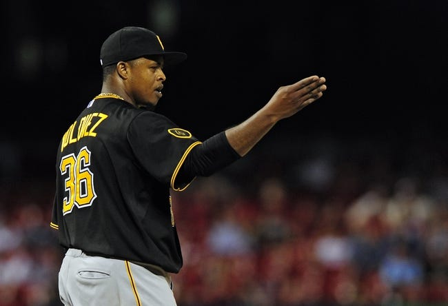 Jul 10, 2014; St. Louis, MO, USA; Pittsburgh Pirates starting pitcher Edinson Volquez (36) celebrates after throwing a complete game against the St. Louis Cardinals at Busch Stadium. Pirates defeated the Cardinals 9-1. Mandatory Credit: Jeff Curry-USA TODAY Sports