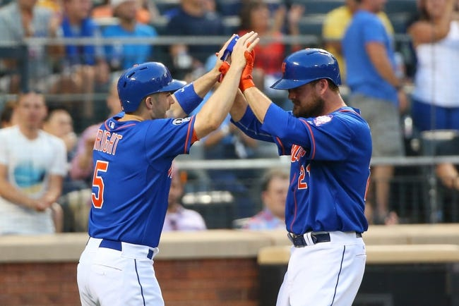 Jul 11, 2014; New York, NY, USA;  New York Mets first baseman Lucas Duda (21) and third baseman David Wright (5) celebrate scoring during the third inning against the Miami Marlins at Citi Field. Mandatory Credit: Anthony Gruppuso-USA TODAY Sports