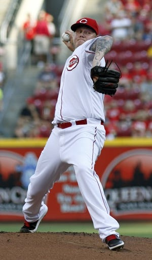 Jul 11, 2014; Cincinnati, OH, USA; Cincinnati Reds starting pitcher Mat Latos throws against the Pittsburgh Pirates in the first inning at Great American Ball Park. Mandatory Credit: David Kohl-USA TODAY Sports