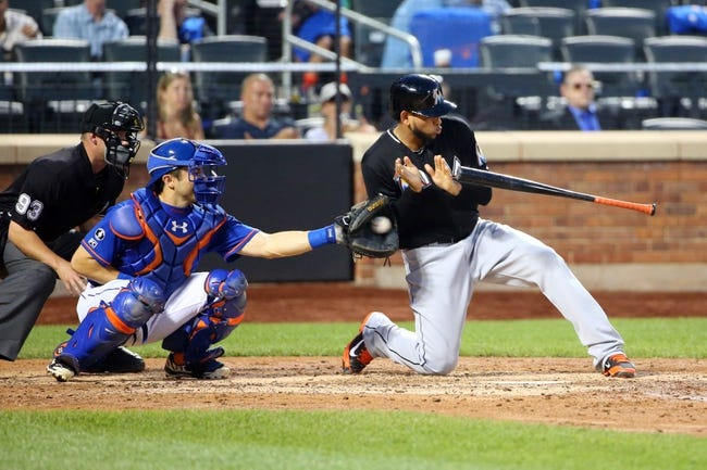 Jul 11, 2014; New York, NY, USA; Miami Marlins starting pitcher Henderson Alvarez (37) backs off a wild pitch during the fifth inning against the New York Mets at Citi Field. Mandatory Credit: Anthony Gruppuso-USA TODAY Sports