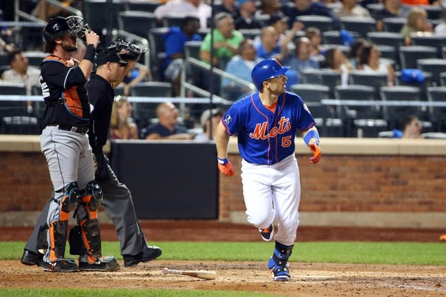 Jul 11, 2014; New York, NY, USA;  New York Mets third baseman David Wright (5) heads out as he watches his home run ball during the fifth inning against the Miami Marlins at Citi Field. Mandatory Credit: Anthony Gruppuso-USA TODAY Sports