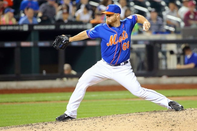Jul 11, 2014; New York, NY, USA;  New York Mets relief pitcher Josh Edgin (66) delivers a pitch during the eighth inning against the Miami Marlins at Citi Field. Mandatory Credit: Anthony Gruppuso-USA TODAY Sports