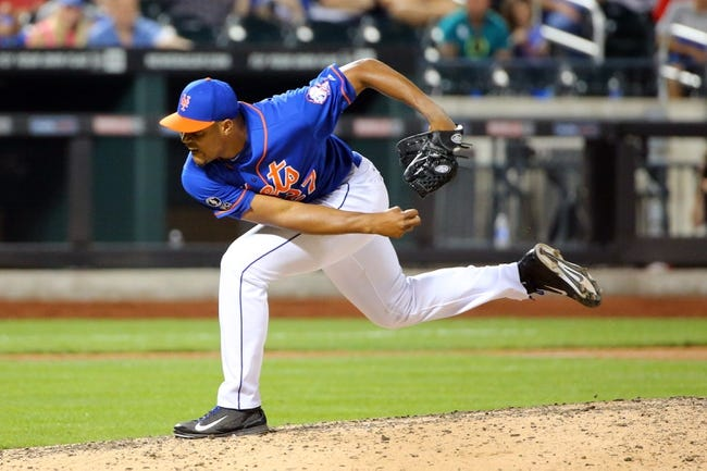 Jul 11, 2014; New York, NY, USA; New York Mets relief pitcher Jeurys Familia (27) delivers pitch during the ninth inning against the Miami Marlins at Citi Field. New York Mets won 7-1.  Mandatory Credit: Anthony Gruppuso-USA TODAY Sports