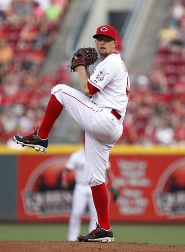 Jul 12, 2014; Cincinnati, OH, USA; Cincinnati Reds starting pitcher Mike Leake (44) pitches during the first inning against the Pittsburgh Pirates at Great American Ball Park. Mandatory Credit: Frank Victores-USA TODAY Sports