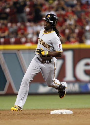 Jul 12, 2014; Cincinnati, OH, USA; Pittsburgh Pirates center fielder Andrew McCutchen (22) rounds second base the game winning home run during the eleventh inning against the Cincinnati Reds at Great American Ball Park. The Pirates defeated the Reds 6-5. Mandatory Credit: Frank Victores-USA TODAY Sports