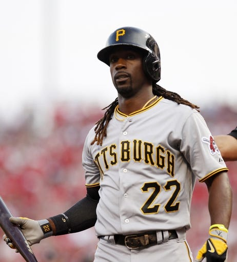 Jul 12, 2014; Cincinnati, OH, USA; Pittsburgh Pirates center fielder Andrew McCutchen (22)  during the first inning against the Cincinnati Reds at Great American Ball Park. Mandatory Credit: Frank Victores-USA TODAY Sports