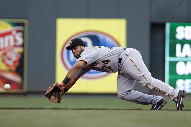 Jul 12, 2014; Cincinnati, OH, USA; Pittsburgh Pirates third baseman Pedro Alvarez (24) dives for a ball during the second inning against the Cincinnati Reds at Great American Ball Park. Mandatory Credit: Frank Victores-USA TODAY Sports