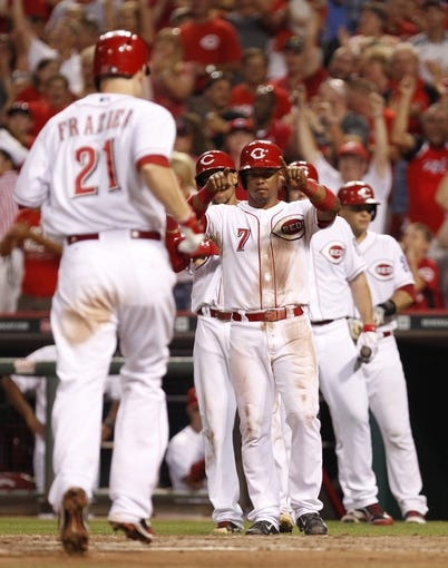 Jul 12, 2014; Cincinnati, OH, USA; Cincinnati Reds third baseman Todd Frazier (21) is congratulated by shortstop Ramon Santiago (7) after hitting a home run during the sixth inning against the Pittsburgh Pirates at Great American Ball Park. The Pirates defeated the Reds 6-5. Mandatory Credit: Frank Victores-USA TODAY Sports