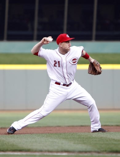 Jul 12, 2014; Cincinnati, OH, USA; Cincinnati Reds third baseman Todd Frazier (21) makes a play during the first inning against the Pittsburgh Pirates at Great American Ball Park. Mandatory Credit: Frank Victores-USA TODAY Sports