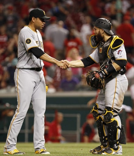 Jul 12, 2014; Cincinnati, OH, USA; Pittsburgh Pirates catcher Russell Martin (55) congratulates relief pitcher Jeanmar Gomez (30) at the end of the game against the Cincinnati Reds at Great American Ball Park. The Pirates defeated the Reds 6-5. Mandatory Credit: Frank Victores-USA TODAY Sports