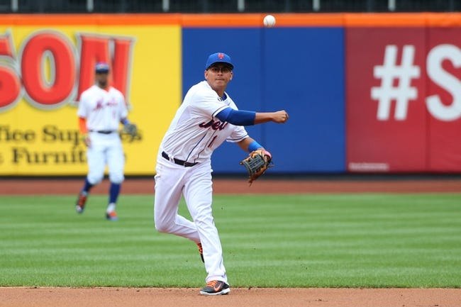 Jul 13, 2014; New York, NY, USA; New York Mets shortstop Ruben Tejada (11) returns a ball for an out during the first inning against the Miami Marlins at Citi Field. Mandatory Credit: Anthony Gruppuso-USA TODAY Sports