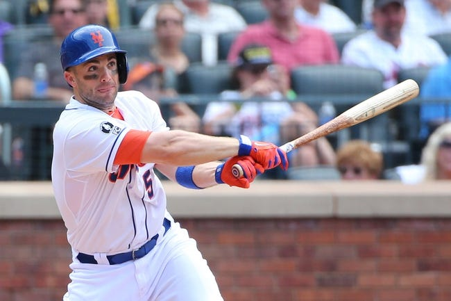 Jul 13, 2014; New York, NY, USA;  New York Mets third baseman David Wright (5) hits a ground rule double to right during the fifth inning against the Miami Marlins at Citi Field. Mandatory Credit: Anthony Gruppuso-USA TODAY Sports
