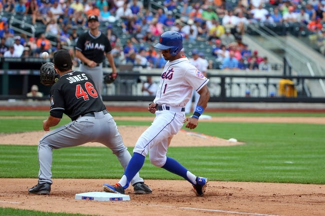 Jul 13, 2014; New York, NY, USA;  New York Mets left fielder Chris Young (1) steps safe back to first as Miami Marlins first baseman Garrett Jones (46) is late with the ball at Citi Field. Mandatory Credit: Anthony Gruppuso-USA TODAY Sports