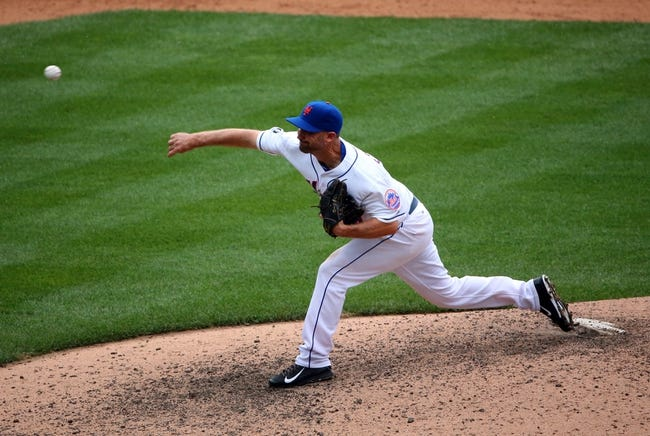 Jul 13, 2014; New York, NY, USA; New York Mets relief pitcher Buddy Carlyle (44) delivers a pitch during the ninth inning against the Miami Marlins at Citi Field. New York Mets won 9-1.  Mandatory Credit: Anthony Gruppuso-USA TODAY Sports
