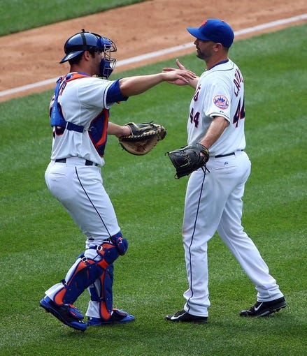 Jul 13, 2014; New York, NY, USA;  New York Mets relief pitcher Buddy Carlyle (44) and catcher Anthony Recker (20) celebrate the win against the Miami Marlins at Citi Field. New York Mets won 9-1.  Mandatory Credit: Anthony Gruppuso-USA TODAY Sports