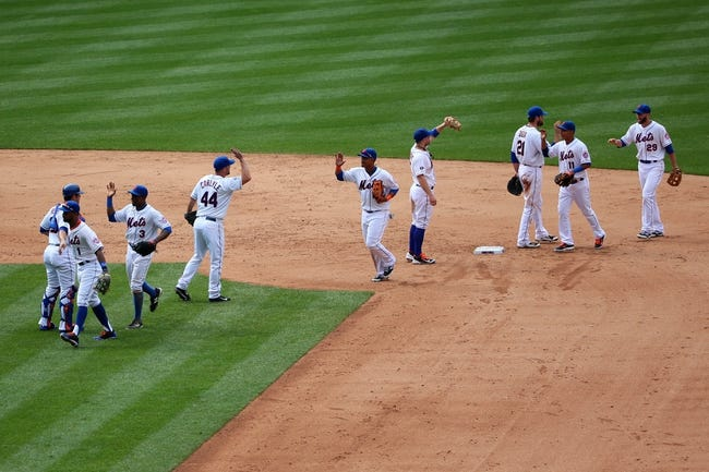 Jul 13, 2014; New York, NY, USA;  New York Mets celebrate the win against the Miami Marlins at Citi Field. New York Mets won 9-1.  Mandatory Credit: Anthony Gruppuso-USA TODAY Sports