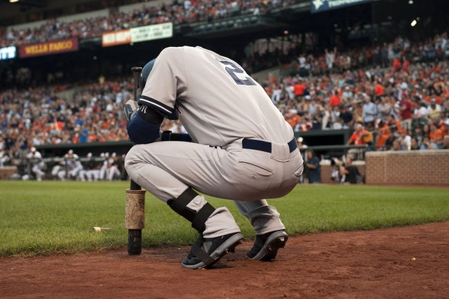 Jul 13, 2014; Baltimore, MD, USA; New York Yankees shortstop Derek Jeter (2) takes a moment before his at bat during the first inning against the Baltimore Orioles at Oriole Park at Camden Yards. Mandatory Credit: Tommy Gilligan-USA TODAY Sports
