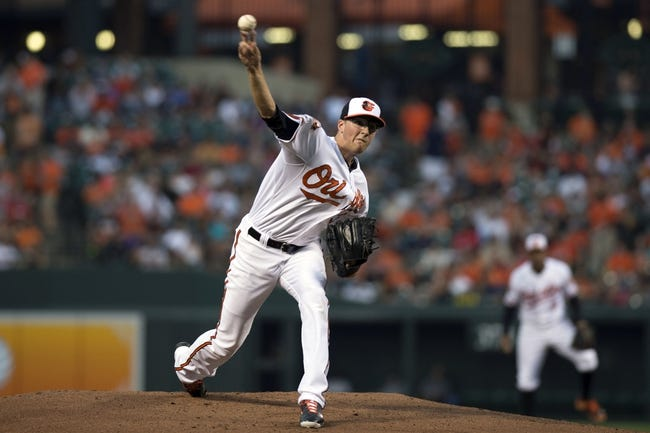 Jul 13, 2014; Baltimore, MD, USA; Baltimore Orioles starting pitcher Kevin Gausman (39) pitches during the first inning against the New York Yankees at Oriole Park at Camden Yards. Mandatory Credit: Tommy Gilligan-USA TODAY Sports
