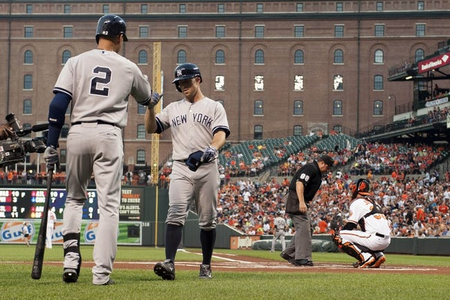 Jul 13, 2014; Baltimore, MD, USA; New York Yankees shortstop Derek Jeter (2) congratulates left fielder Brett Gardner (11) after he hit a home run  during the first inning Baltimore Orioles at Oriole Park at Camden Yards. Mandatory Credit: Tommy Gilligan-USA TODAY Sports
