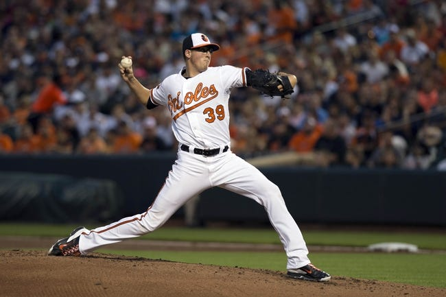 Jul 13, 2014; Baltimore, MD, USA; Baltimore Orioles starting pitcher Kevin Gausman (39) pitches during the second inning against the New York Yankees at Oriole Park at Camden Yards. Mandatory Credit: Tommy Gilligan-USA TODAY Sports