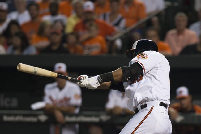 Jul 13, 2014; Baltimore, MD, USA; Baltimore Orioles designated hitter Nelson Cruz (23) singles during the second  inning against the New York Yankees at Oriole Park at Camden Yards. Mandatory Credit: Tommy Gilligan-USA TODAY Sports
