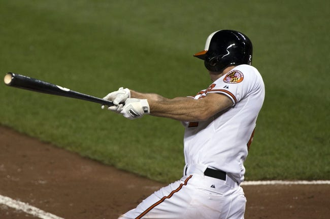 Jul 13, 2014; Baltimore, MD, USA; Baltimore Orioles shortstop J.J. Hardy (2) hits a double during the during the fourth inning against the New York Yankees  at Oriole Park at Camden Yards. Mandatory Credit: Tommy Gilligan-USA TODAY Sports