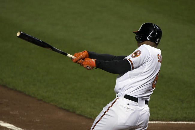 Jul 13, 2014; Baltimore, MD, USA; Baltimore Orioles second baseman Jonathan Schoop (6) hits a RBI single during the fourth inning against the New York Yankees at Oriole Park at Camden Yards. Mandatory Credit: Tommy Gilligan-USA TODAY Sports