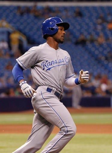 Jul 7, 2014; St. Petersburg, FL, USA; Kansas City Royals center fielder Jarrod Dyson (1) singles against the Tampa Bay Rays at Tropicana Field. Mandatory Credit: Kim Klement-USA TODAY Sports