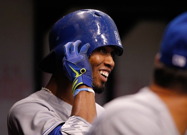 Jul 7, 2014; St. Petersburg, FL, USA; Kansas City Royals shortstop Alcides Escobar (2) smiles in the dugout against the Tampa Bay Rays at Tropicana Field. Mandatory Credit: Kim Klement-USA TODAY Sports