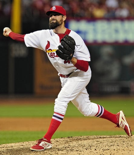 Jun 17, 2014; St. Louis, MO, USA; St. Louis Cardinals relief pitcher Pat Neshek (41) throws to a New York Mets batter during the ninth inning at Busch Stadium. The Cardinals defeated the Mets 5-2. Mandatory Credit: Jeff Curry-USA TODAY Sports