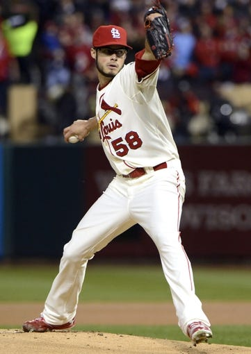 Oct 26, 2013; St. Louis, MO, USA; St. Louis Cardinals starting pitcher Joe Kelly throws a pitch against the Boston Red Sox in the first inning during game three of the MLB baseball World Series at Busch Stadium. Mandatory Credit: Eileen Blass-USA TODAY Sports