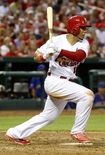 Jun 17, 2014; St. Louis, MO, USA; St. Louis Cardinals right fielder Jon Jay (19) hits a one run triple off of a New York Mets starting pitcher during the fifth inning at Busch Stadium. Mandatory Credit: Jeff Curry-USA TODAY Sports