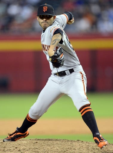 Jun 21, 2014; Phoenix, AZ, USA; San Francisco Giants relief pitcher Sergio Romo (54) pitches in the ninth inning against the Arizona Diamondbacks at Chase Field. The Giants won 6-4. Mandatory Credit: Joe Camporeale-USA TODAY Sports